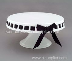 Ceramic cake stand... change out the ribbon