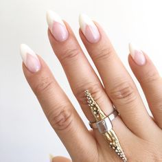 Pointed nails look extra sharp and chic with a deep V french manicure!