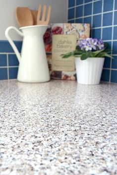 Can you believe these countertops are actually just contact paper? It made a huge difference in our ugly 80s kitchen, without the huge cost of buying them new! - The Handyman's Daughter