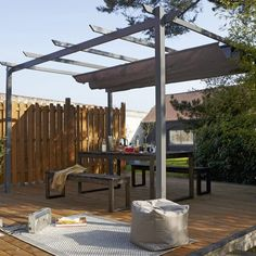 Tonnelle bois avec voilage Whilst historical in notion, this pergola is suffering from somewhat of Patio Bar, Patio Roof, Whirlpool Pergola, Hot Tub Pergola, Wooden Arbor, Electric Awning, Small Outdoor Spaces, Shade Canopy, Parasols
