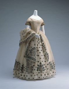Beetle wing embroidered ball gowns were the crème de la crème of fashion in the 1850s. This gown is decorated with beetle wing beetles! and also has a matching shawl.