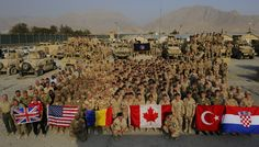 This picture taken in Afghanistan. when you look at this picture you will feel proud and positive that soldiers from different country are working together to fill the earth with peace. Pictures Of Soldiers, Imagine John Lennon, Military Branches, Armed Forces, Afghanistan, All Over The World, Dolores Park, Thankful, The Unit