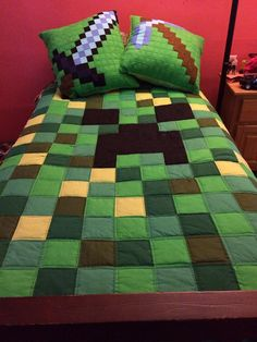Minecraft bed quilt and pillows: The pillows are the Diamond Pick Axe and the Diamond Sword, but you knew that, right?