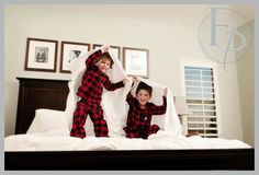 family christmas photo, two kids jumping on bed
