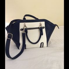 Charming Charlie Handbag Adds a stylish glow to any outfit.  Roomy enough to carry all your essentials. The Zipper doesn't flow perfect, price will reflect minor flaw in zipper.  Height 13 inches.   Width at widest part 18 inches depth 6 1/2 inches Charming Charlie Bags Crossbody Bags