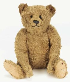 A fine Steiff centre-seam teddy bear with golden mohair, black boot button eyes, pronounced clipped muzzle, hump, growler and button in ear 19¾in. high, circa 1908.