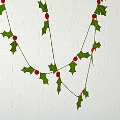 Shop Boughs of Holly Christmas Garland.  Spread some holiday cheer with our Boughs of Holly Garland.  It features festive holly berries constructed from wool felt and can be hung on a Christmas tree, mantel, or even a window.