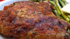 Pork chops are breaded with Italian breadcrumbs and Parmesan cheese then baked for a flavorful dinner.