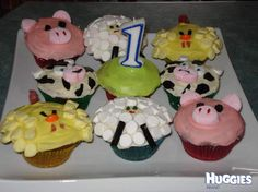 Cupcakes decorated with buttercream icing and various other lollies to create a pig, a cow, a sheep and a duck.