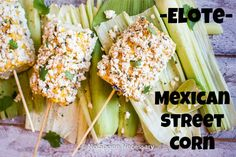 Elote- Mexican Street Corn on a Stick.  Sweet, Smoky, Salty, Cheesy & Absolutely Delicious!