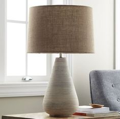 This table lamp is a modern classic. Crafted of mango wood with a distressed whitewash finish and ribbed carving for rich textural dimension. Table Lamps Uk, Wooden Pillars, Outdoor Cushions And Pillows, Room Lamp, Lamp Design, Midcentury Modern, Bedding Shop, Home Accessories, Modern Classic