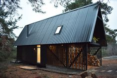 The home is spread across two floors. Tagged: Exterior, Metal Roof Material, Gable RoofLine, Metal Siding Material, and Cabin Building Type. Photo 9 of 11 in A Patagonian Prefab Cabin Is Built to Withstand Volatile Climates. Cabin Design, House Design, Garage Design, Design Design, Prefab Buildings, Cabin In The Woods, A Frame Cabin, Wood Siding, House And Home Magazine