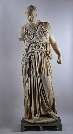 """Statue of Athena with """"crossed aegis"""" Pergamon, Athenaheiligtum (found under the Berlin excavations 1880) to 150 v. Chr., Marble, height 1.86 m Her robe is at the waist with a belt together amount haten from snakes. Snakes also line the lower edges of her chest protection (Aegis), which here consists of two intersecting bands (""""crossed aegis""""). The head was working as a head-set. He has been missing since 1945 in Russia and replaced by a casting. Pergamon Museum, Berlin"""