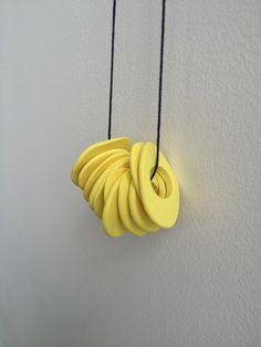Yellow Hand Shaped Polymer Clay Necklace by hopeofallhearts