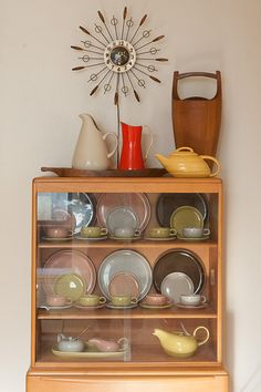 Russel Wright casual dining china in the cabinet and other artifacts created between 1939 and the 1960s. ohhhhh