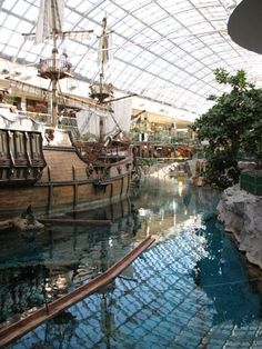 West Edmonton Mall. Alberta, Canada. The biggest mall I have ever been to. It has a pirate ship, a water park, cinemas, shops, restaurants and you could even ride a submarine or dive with dolphins!