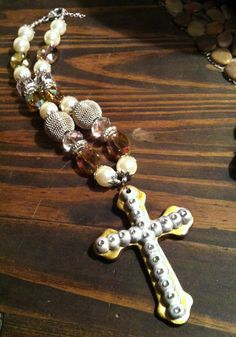 Absolutely elegant silver and gold cross necklace by JESSESJEWELZ, $50.00