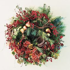 Lovely—Traditional evergreen & red berry Christmas wreath—Love the addition of the little pears!