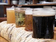 The beer flight, served in a carved-out branch, at the newly opened Bronx Beer Hall.