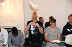 Leicester goalkeeper Mark Schwarzer (centre) watches the dough carefully as it floats gently down to him while making pizza