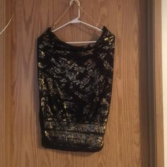 NWOT Wet Seal Black and Gold Chain Tank Gorgeous Black with gold patterns on front only. Slight cut out low back. Neckline is Gold color chain. Unique and beautiful. NWOT took tags off because I was going to wear it then I decided it wasn't right for the occasion. Black is black black. Never been worn. Just tried on. It's a medium fit small, medium and large. Wet Seal Tops Tank Tops