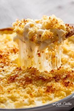 Garlic Parmesan Mac And Cheese is better than the original! A creamy garlic parmesan cheese sauce coats your pasta topped with parmesan fried bread crumbs!