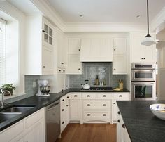 backsplash color -- something I hadn't considered before, but this has really caught my eye. I have same colors white cabinets/black countertops.