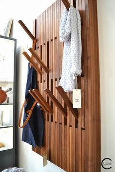 DIY: a wall of fold-down pegs (just push them back into the wall when you're not using them!)