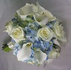 Pretty bouquet incorporating calla Lillie's, blue hydrangea, and roses. Make the roses a slight Pink and it'd be perfect!