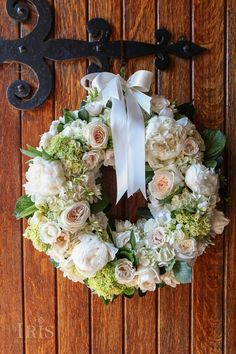 A wreath of soft garden roses, peonies, and hydrangeas.