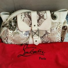 """AUTHENTIC Christian Louboutin purse Authentic and beautiful Christian Louboutin leather snakeskin shoulder purse with double straps. Signature red interior, and comes with dustbag. Working pockets on each side. Stunning, stunning, stunning! Very little wear- see pic 2. Measurements: 7.5"""" high, 14"""" long, 5.5"""" wide. Strap drop: 7"""". No trades. Please make offers through the offer button. Christian Louboutin Bags Shoulder Bags"""