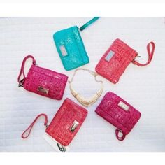 Nine West Wristlets  Each sold separately!! Brand new with tags! Only orange and blue left! Nine West Bags