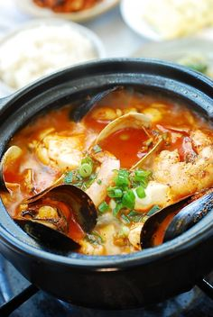 Haemul Sundubu Jjigae (Seafood Soft Tofu Stew) - Korean Bapsang This bubbling hot, hearty stew is made with extra soft tofu (sundubu or soondubu) and seafood. It cooks up so fast, making it perfect for a weeknight meal! Seafood Stew, Seafood Dishes, Seafood Recipes, Cooking Recipes, Korean Seafood Tofu Soup Recipe, Cooking Tips, Korean Dishes, Korean Food, Korean Cake