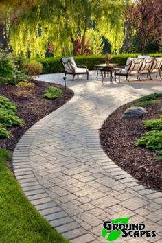 Stone walkway leading to patio with seating area