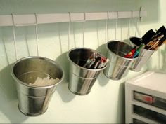buckets and rail from IKEA kitchen department, use some antiques and it will be really cool, great idea ikea:)