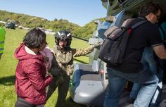 A handout photo taken and received on 15 November 2016, shows a New Zealand Defence Force helicopter evacuating some of 1,200 of tourists from Kaikoura stranded by a 7.8 earthquake that caused devastation on the east coast of the South Island.