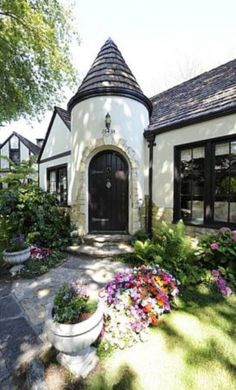 CURB APPEAL – another great example of beautiful design. Turret entry on storybook style cottage.