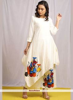 Product Features: Color: White Fabric: Linen Garment Fit: Regular Fit Sleeve Length: Sleeves Neck Type: Round Neck Care Instructions: Dry Clean Only Disclaimer: It is Made to order/Custom made products and cannot be exchanged or returned. Dress Neck Designs, Designs For Dresses, Blouse Designs, Saree Painting Designs, Fabric Paint Designs, Fabric Design, Hand Painted Dress, Painted Clothes, Indian Designer Outfits