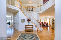 HOME OF THE DAY - Experience grand-scale elegance in gorgeous estate home with open floor plan, 2 story foyer, 2 story family room with 7 Palladian windows and stone fireplace, and conservatory retreat. Oversize gourmet kitchen, stately dining room, library, two staircases, private deck with arbor, lake views, and 2-3 car garage. Premium cul de sac lot in Farmwell Hunt. Over 4000 square feet to fulfill your desires - http://search.psahomes.com/idx/details/homes/a004/LO8110739/43762-CARSON-CT