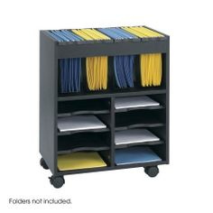 """NEW - GoCarts Mobile File, 14-1/2w x 21-1/2d x 26-1/4h, Black - 5390BL by Safco. $236.34. 21. Versatile and adjustable literature trays for the storage of flat materials and tubs for hanging files. Six pull-out 9-5/8w x 11-5/8d shelves form up to eight letter size compartments to meet your personal filing needs. Fits neatly under most worksurfaces when not in use. Color: Black; Overall Width: 14 1/2""""; Overall Depth: 21 1/2""""."""