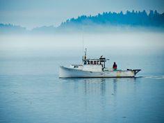 Lobstermen leaving the harbor on a foggy morning. Eastport, ME