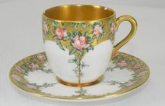 Coalport fine porcelain demmi tasse and saucer , printed with rose border on gilded background and gilded inside . Dates from around 1900...