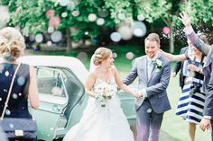 the most amazing wedding confetti at Cooling Castle Barn in Kent - mint Ford Cortina, confetti, Kent wedding photography