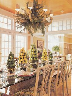 Holiday dining - too much citrus on the table for my preference, but I love the understated elegance of the cedar in the chandelier