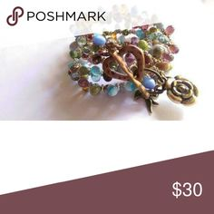 Czech Slovakian brass copper charm wrap This is a stunning Czech Slovakian beads teardrop multi colored wrap with chain and large brass copper toggle clasp and charms by earth and sea jewelry Jewelry Bracelets