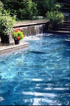 Beautiful pool with waterfall and plants around the outside! Mr. Rooter can take care of that plumbing for you!