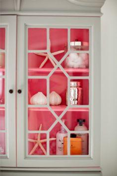 pretty pop of pink inside armoire