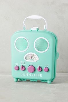 Sunny Life Beach Radio. Tunes on the beach are a must, but who wants to get their technology sandy, salty and sunblock-y? Tuck your MP3 player inside this water-resistant AM/FM speaker box for your worry-free listening pleasure. #anthropologie #MustHave
