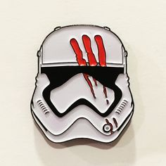 """1.25"""" black dyed enamel pin. Double rubber clutch on back. Comes on 6x4 postcard backing."""