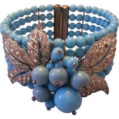 This is an early unsigned Miriam Haskell Bracelet and can be seen in Cathy Gordon's Miriam Haskell Jewelry book on page 153. It is book valued at $600